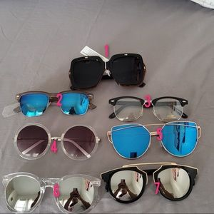 Sunglasses new with litters scratches no return no